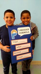 Boys at The Providence Center's After-School Program learn communication skills for conflict resolution.